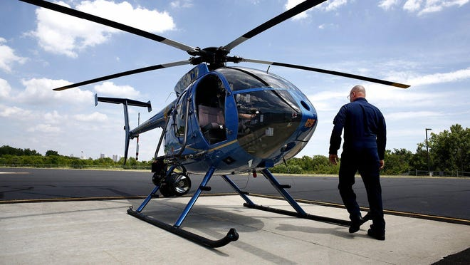 Lt. Jack Harris approaches a Columbus Division of Police helicopter at the department's helipad on the Hilltop.
