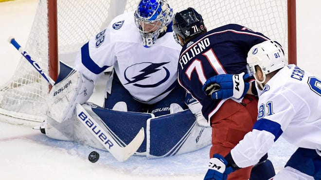 Blue Jackets left wing Nick Foligno (71) attempts a shot on Tampa Bay goaltender Andrei Vasilevskiy (88) as defenseman Erik Cernak (81) trails in the first period in game 4 of the first round of the 2020 Stanley Cup playoffs at Scotiabank Arena.