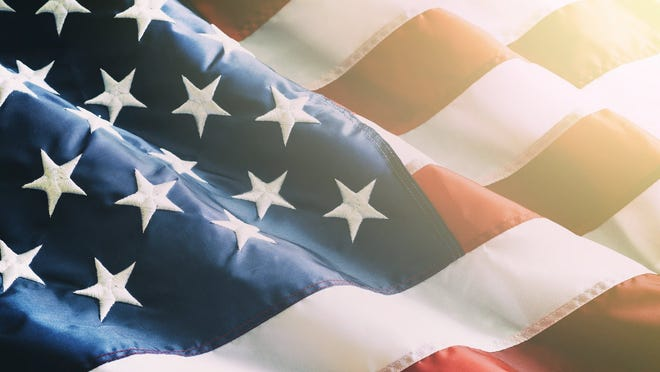 American flag waving in the sun