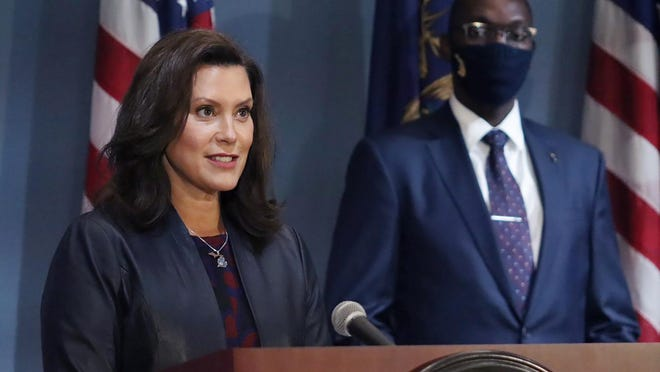 In this Wednesday, Sept. 2, 2020 file photo provided by the Michigan Office of the Governor, Gov. Gretchen Whitmer addresses the state during a speech in Lansing. Gov. Gretchen Whitmer said Monday that a statewide mask requirement remains in effect despite the Michigan Supreme Court's invalidation of a law that underpins her orders to control the coronavirus pandemic.
