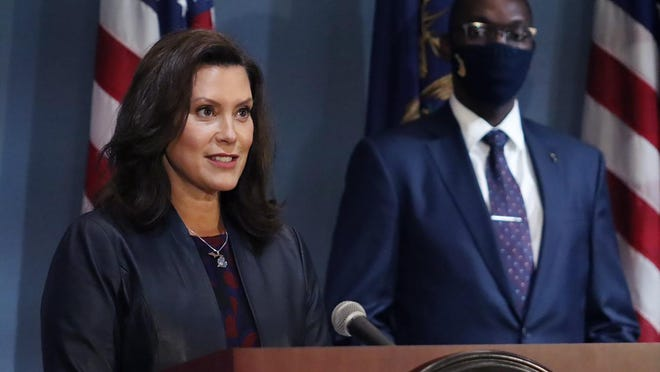 In this Tuesday, Sept. 2, 2020 file photo provided by the Michigan Office of the Governor, Gov. Gretchen Whitmer addresses the state during a speech in Lansing, heir status amid the coronavirus pandemic. Whitmer says gyms can reopen after 5 1/2 months of closure and organized sports can resume if masks are worn. She lifted some coronavirus restrictions Thursday, Sept. 3, 2020, that lasted longer in Michigan than in many other states. The order, effective next Wednesday, allows for reopening fitness centers and indoor pools in remaining regions that hold 93% of Michigan's population.