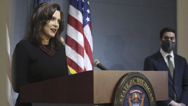 Michigan Gov. Gretchen Whitmer speaks during a news conference Friday in Lansing. Whitmer lifted Michigan's nearly 10-week coronavirus stay-at-home order Monday, letting restaurants reopen to dine-in customers next week and immediately easing limits on outdoor gatherings while keeping social-distancing rules intact.