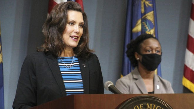 In this photo provided by the Michigan Executive Office of the Governor, Gov. Gretchen Whitmer speaks during a news conference Thursday, May 28, 2020, in Lansing, Mich. Whitmer urged the federal government to give the state more flexibility to spend coronavirus rescue aid to fill budget shortfalls and to pass another round of relief funding.