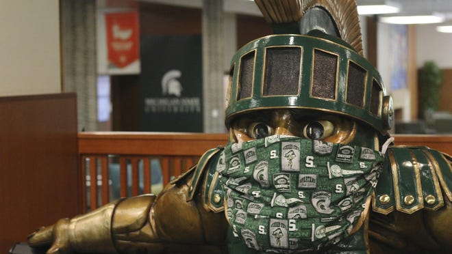 A face mask on the Sparty statue inside the the Michigan State University Student Union is seen on Friday, Aug. 21, 2020.
