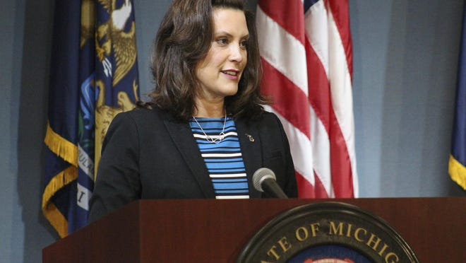 In this photo provided by the Michigan Executive Office of the Governor, Gov. Gretchen Whitmer speaks during a news conference Thursday, May 28, 2020, in Lansing, Mich. A petition to repeal the emergency law Whitmer is using to manage the coronavirus pandemic will be on the streets in Michigan within a couple of days, a spokesman for the group backing the petition said Monday.