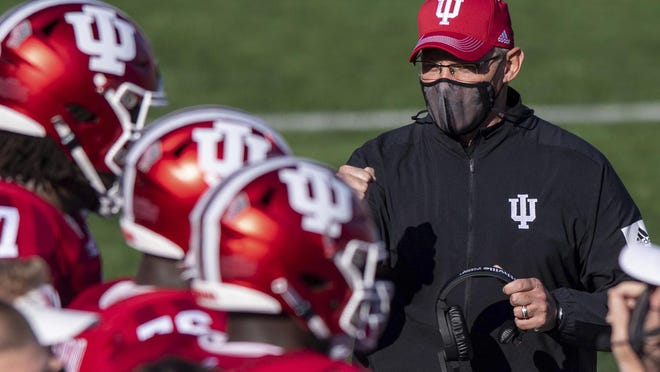 Indiana head coach Tom Allen paces the sideline in front of the team's bench during a break in the second half of an NCAA college football game against Michigan, Saturday, Nov. 7, 2020, in Bloomington, Ind. Indiana won 38-21.