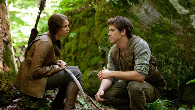 """Jennifer Lawrence and Liam Hemsworth appear in a scene from """"The Hunger Games,"""" much of which was filmed in WNC."""