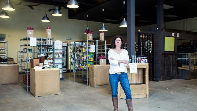 Missy Culver stands in her store, Livi's Pantry, on her last day in business last week in Reynolds Village, a little-known development north of Asheville. Culver started when the development opened in 2008, and has had to close because of too-little business in the area.