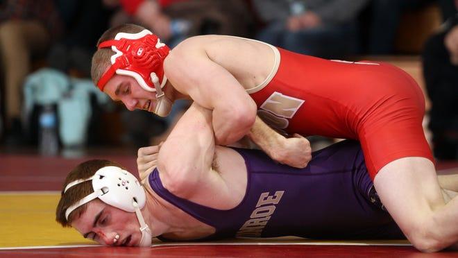 Shawn Gardini of Monroe wrestles Robert Cleary of Edison in the 120lb match, Wednesday, January 14, 2015, in Edison, NJ. Jason Towlen/Staff Photographer