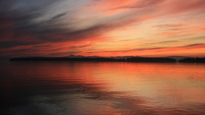 The sun sets over Lake Champlain, captured from South Hero.