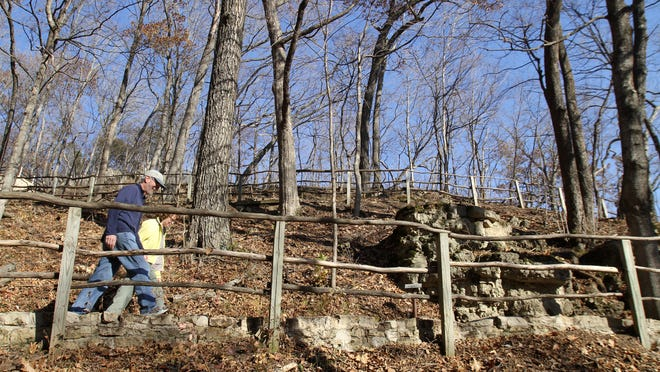 Paul and Sue Schramm of Dyersville hike at Effigy Mounds National Monument. The National Park Service approved illegal projects at the sacred Indian burial sites.