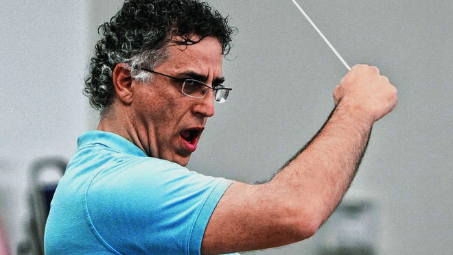 New Southwest Florida Symphony Maestro Nir Kabaretti demonstrates his intensity during practice at the Riverside Community Center in Fort Myers Monday, January 12.