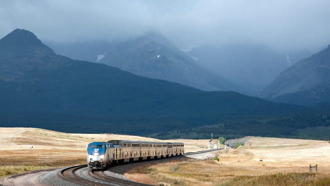 Amtrak's Empire Builder rounds a turn near East Glacier Park. Daily passenger rail service aboard Amtrak will return to Montana's Hi-Line within the next 90 days, after it was cut to just three-days a week last October.