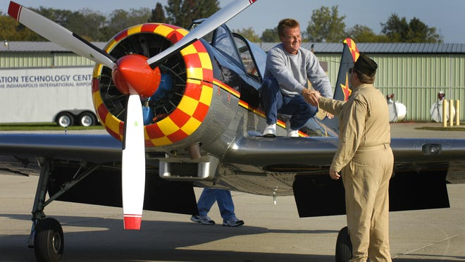 Glenn Foy, a pilot from Indianapolis, is greeted by World War II re-enactor Rodney Davis, Fishers, after climbing from the cockpit of his Yak 52 aircraft during an appearance at the Greenwood Airport Open House Static Air Show in September 2006. Indianapolis police said on Saturday that they are searching for Foy after he went missing after flying out of Eagle Creek Airport on April 5.