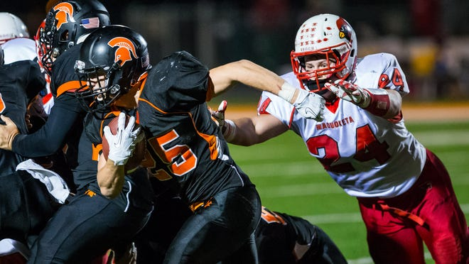 Solon's Brandon Kramer (25) escapes a tackle by Maquoketa's Jordan Rapp (24) and continues to run for a 90-yard touchown in the second quarter Friday at Spartan Stadium in Solon.