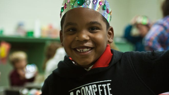 """Kindergartener Jordan Crawford convinced his mom, Brandy, to bring him to the """"Nacho Ordinary Fairy Tale"""" Literacy Night on Thursday at Pope Elementary School."""