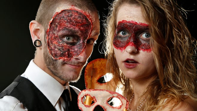 Eric Hintz and Julia Branstrator sport ghoulish makeup Wednesday as they get ready for the Half Moon Masquerade at Carnahan Hall this weekend.