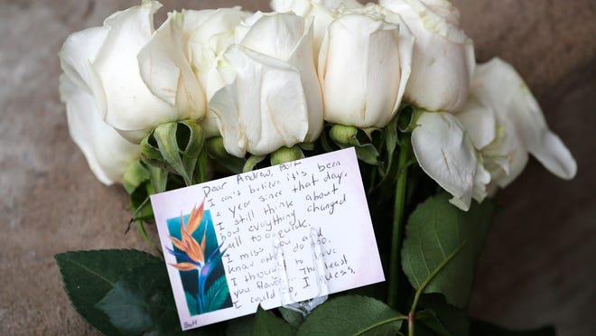 A bouquet of flowers along with a note addressed to Andrew Boldt next to a door on the north side of the Electrical Engineering Building Wednesday, January 21, 2015, on the campus of Purdue University. Boldt was murdered in a shooting January 21, 2014, in the Electrical Engineering Building. A moment of silence was observed on campus at noon Wednesday to commemorate the first anniversary of Boldt's death.