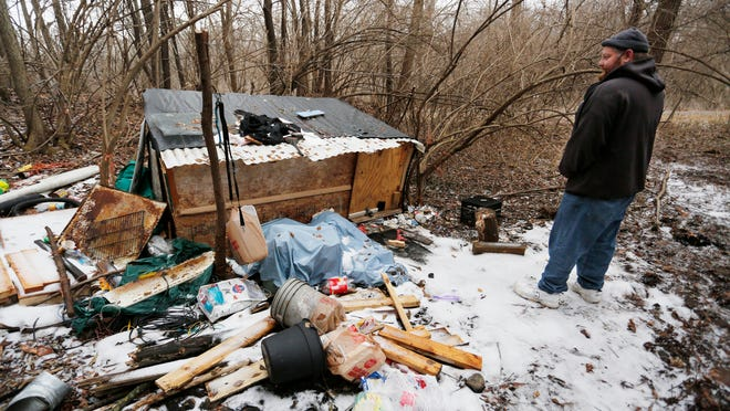 Here's how the homeless site looked on Jan. 28. Since then, the city of Lafayette has demolished the site, displacing its occupant. In this picture, Chris Galbreth surveys the shanty during the Point-in-Time homeless count. The shack was empty Jan. 28 but known to be an active camp site.