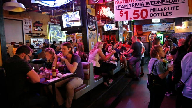 A crowd packs Jake's Roadhouse in West Lafayette. General manager Jose Fogleman said the clientele seems tamer than in years past.