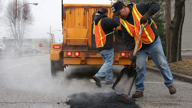 People can report potholes in Metro Louisville to MetroCall, 311.