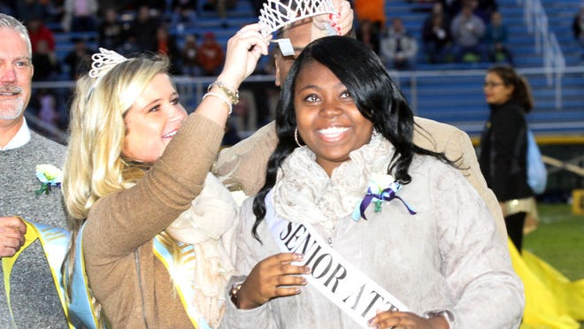 River Valley senior Lanecia Jones is crowned 2014 homecoming queen by last year's queen Emma Christman during homecoming ceremonies before the Vikings' game against Galion.