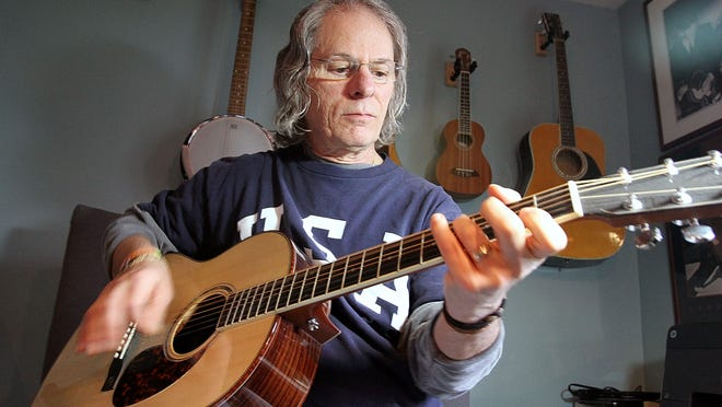 """Marion songwriter Benn Cutarelli performs """"Small Stuff,"""" a song he co-wrote with writing partner Dan Robinson. The song can be heard in the movie """"The Longest Ride,"""" which is adapted from the book of the same name by Nicholas Sparks. The movie opens Friday at Marion Centre Cinemas and nationwide."""