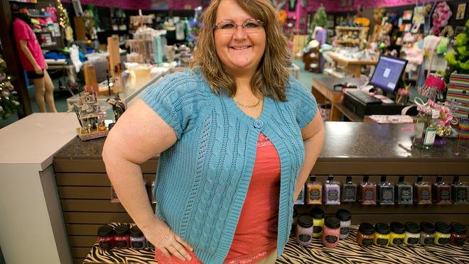 Pink Zebra Boutique owner Charlotte Merwin poses at the Pink Zebra Boutique at the Marshfield Mall.