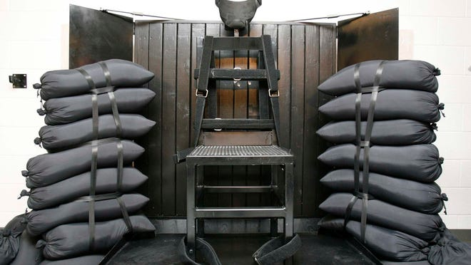This June 18, 2010, file photo shows the firing squad execution chamber at the Utah State Prison in Draper, Utah. In Arkansas, Republican Rep. Rebecca Petty of Rogers said she plans to introduce a bill this week instructing the state to consider other execution methods, including firing squads.