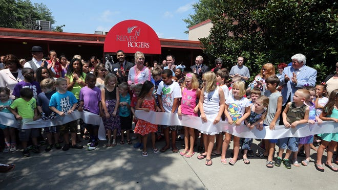 Reeves-Rogers Elementary students and school administrators cut a ribbon at the start of an open house Sunday at the Greenland Drive campus.