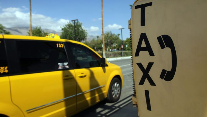 FILE - Coachella Valley cities could block private drivers from waiting near the entrances to hotels and restaurants under a new idea floated among local leaders to help cab drivers compete against Uber and other rideshare companies.