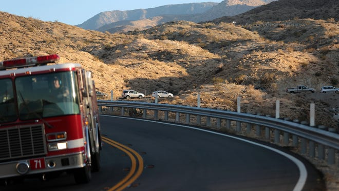 Traffic is backed up for several turns in the uphill lane of Highway 74 as a fire truck makes its way down the mountain following a vehicle collision near Vista Point which shut down the roadway on Wednesday afternoon, November 19, 2014 above Palm Desert, Calif.