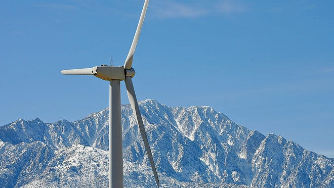 A wind turbine generates electricity near Desert Hot Springs, California, with Mount San Jacinto in the background.