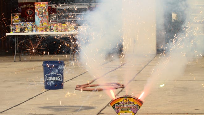 """Delirium, a """"safe and sane"""" firework, sends out sparks during a 2014 safety presentation by Cathedral City firefighters."""