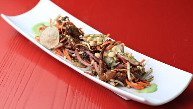 The Crispy Pig Ear Pad Thai appetizer is effectively presented with cilantro yogurt, peanuts, pickled Fresno chile and XO sauce.