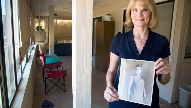 Rosa Sullivan, pictured in her home, holds a photo of herself when she was acting in college on Thursday, May 15, 2014 in Peoria, Arizona. As a hobby, Sullivan performs with the Westbrook Village Players.