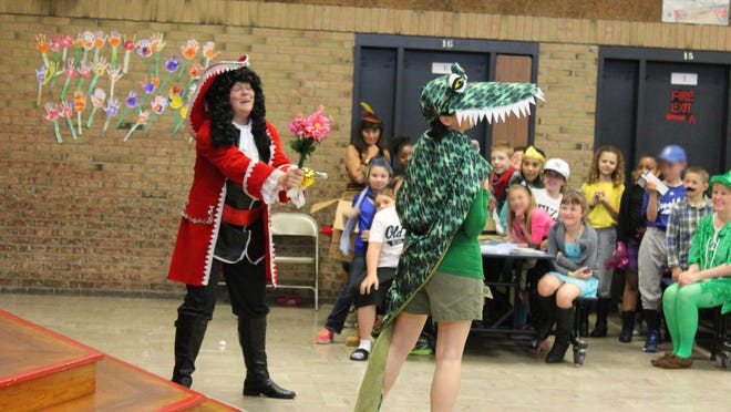Colleen Giametta, left, as Captain Hook, and Leigh Weaver, as Crocodile, put on a skit.