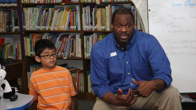 Duzine Elementary School second-grader Zenon Galvan listens as James Childs talks about diversity and acceptance.