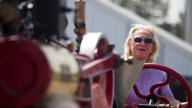 Barbara Conroy, 73, of Matlacha, Florida, drives a Lang and Button steam engine Thursday through the Pageant of Steam in Canandaigua. Conroy and her husband owned the engine from 1967 to 1976. This is the first time she has driven it since 1976.