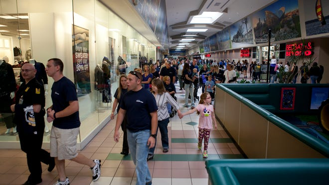 A   charity walk hosted by Operation Patriot Foundation moves through the Mall at Greece Ridge Mall on Saturday in honor of Rochester Police Officer Daryl Pierson.