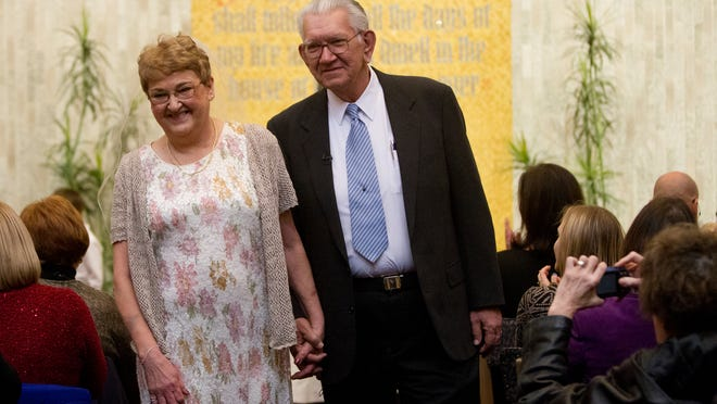 Esther FitzRandolph and Dan Pszczolkowski walk past their loved ones following their commitment ceremony in the Interfaith Chapel at Strong Hospital on Saturday.