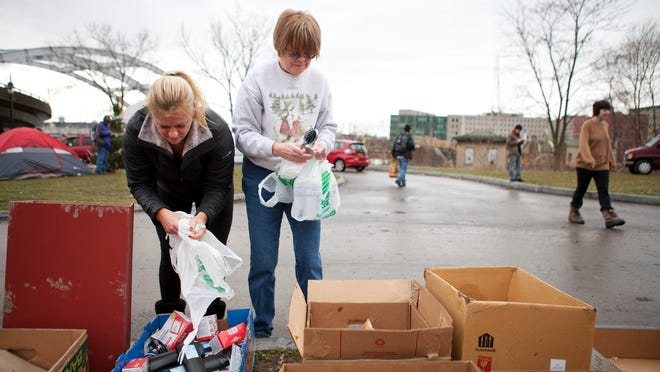 Lisa Brown of Ogden and Ruth Dockter organize donations at Sanctuary Village on Wednesday.