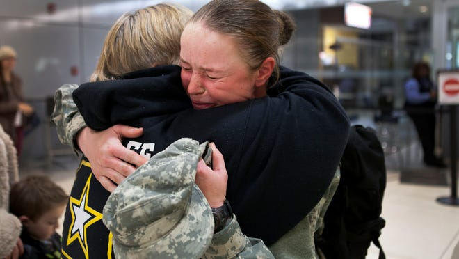 Angelina Metcalfe hugs her mom, Bobbie, after returning home for the holidays Dec. 18 at the Greater Rochester International Airport.