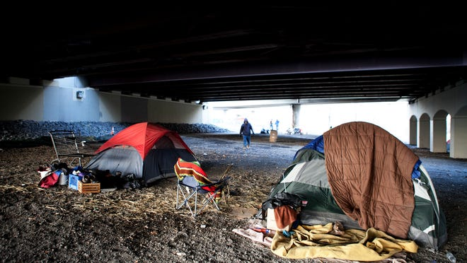 Some homeless people camped under the Douglass-Anthony Bridge last winter before moving to a temporary shelter on Canal Street.