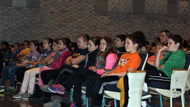 Fifth graders sit in rapt attention as they listen to the concert. (Photo: Jen Calus)
