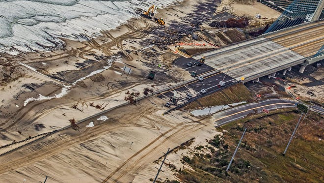 Superstorm Sandy left sand across the approach to the Indian River Inlet Bridge on Del. 1 on Oct. 30, 2012.