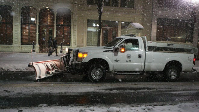 A Wilmington snow plow clears Market Street after a snowfall on Jan. 21.