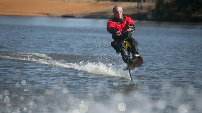 Bob Coley takes to the waters of Lake Wazeecha in Grand Rapids on Saturday to hydrofoil for the first time since his accident, where he burned 40 to 60 percent of his body.
