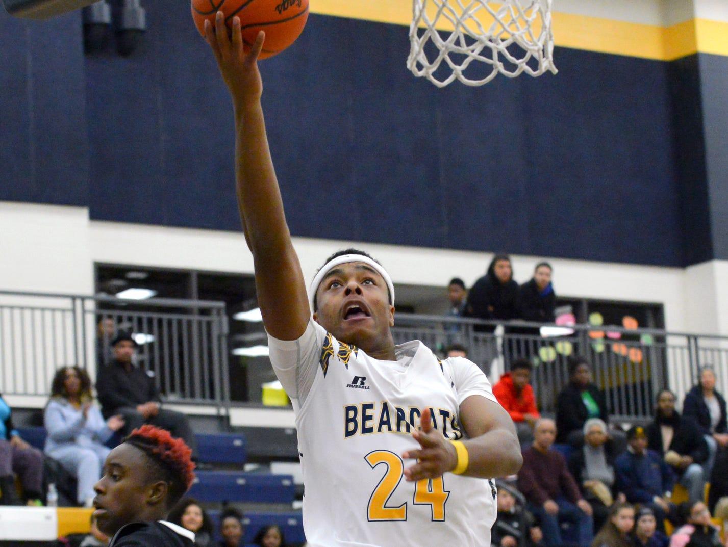 Battle Creek's Cyntell Williams drives the basket Tuesday night.