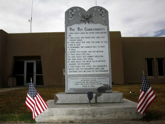 Bloomfield Ten Commandments monument is seen, Thursday, March 13, 2014, at Bloomfield City Hall in Bloomfield, N.M.